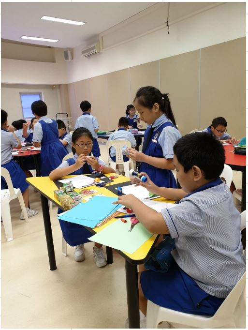 Students doing paper sculpture